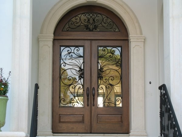 Elegant Mahogany and Glass Arch Double Front Door Home Design photo - 2