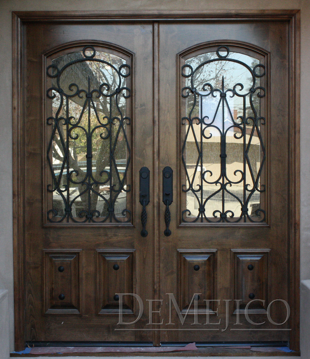 Elegant Mahogany and Glass Arch Double Front Door Home Design photo - 9