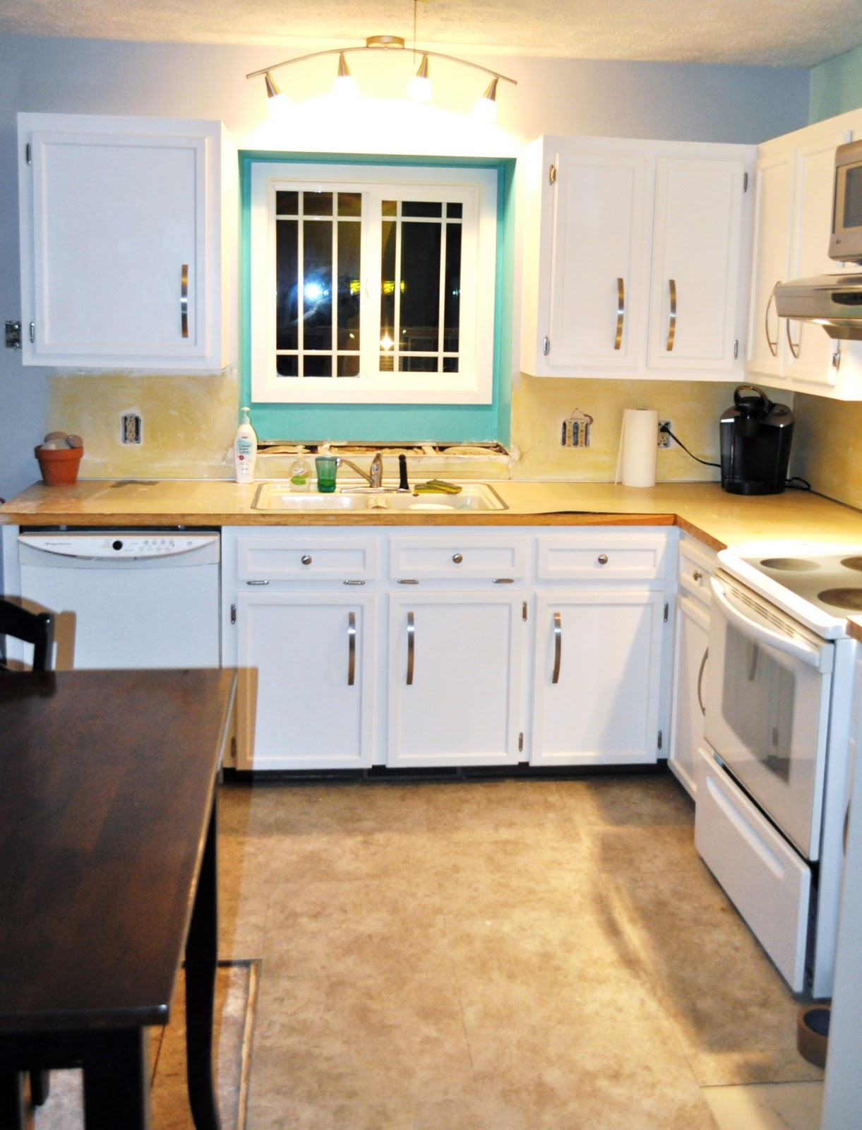 White Kitchen Interior With Wooden Countertop Photo 1