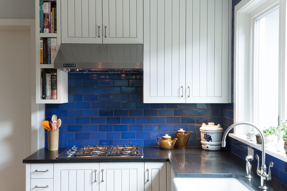 White Kitchen with Dark Blue Tiling photo - 10