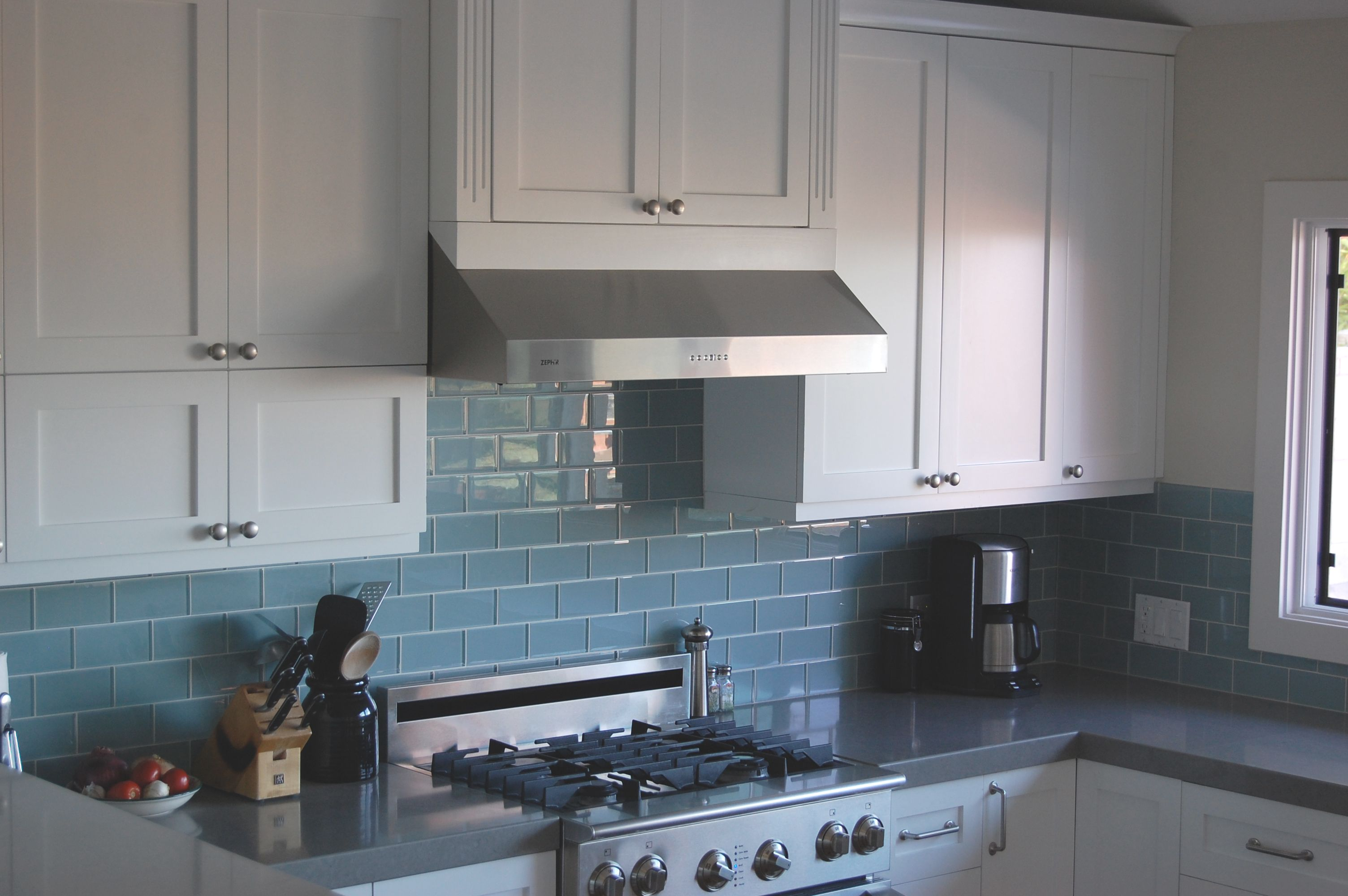 White Kitchen with Dark Blue Tiling photo - 4