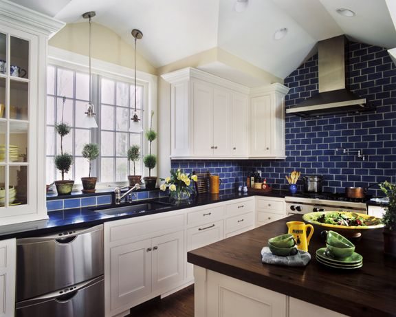White Kitchen with Dark Blue Tiling photo - 6