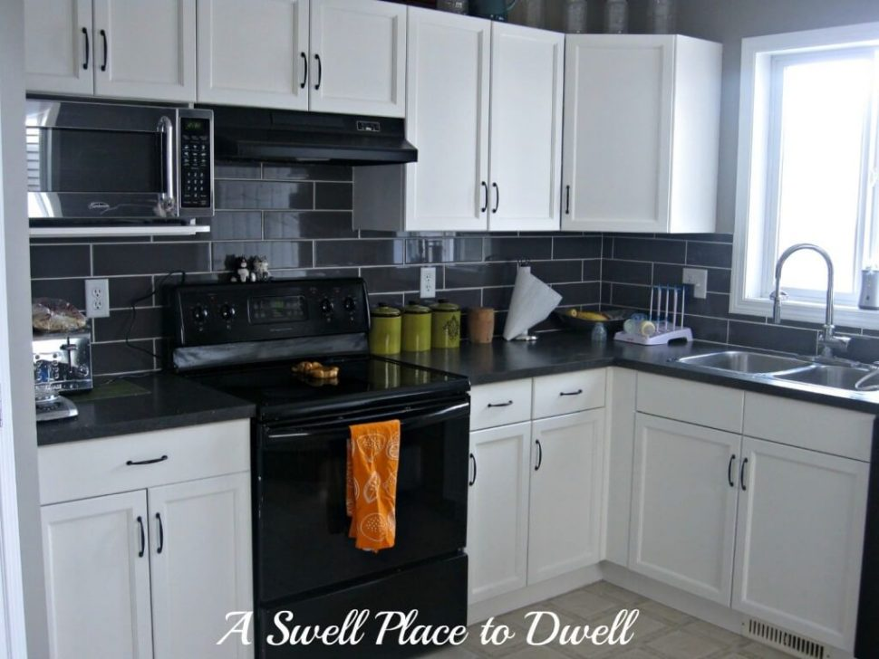 White Kitchen with Dark Blue Tiling photo - 7