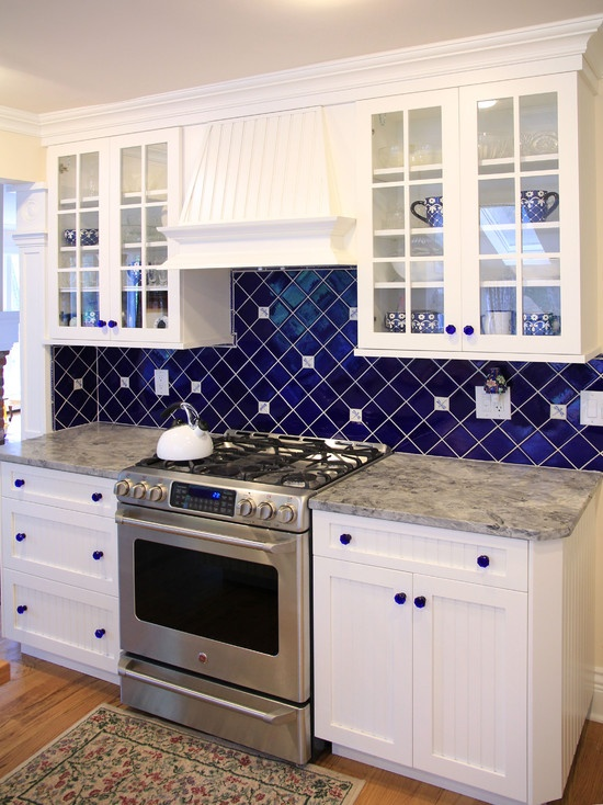 White Kitchen with Dark Blue Tiling photo - 8