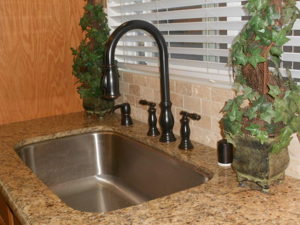 black granite sink and faucet photo - 10