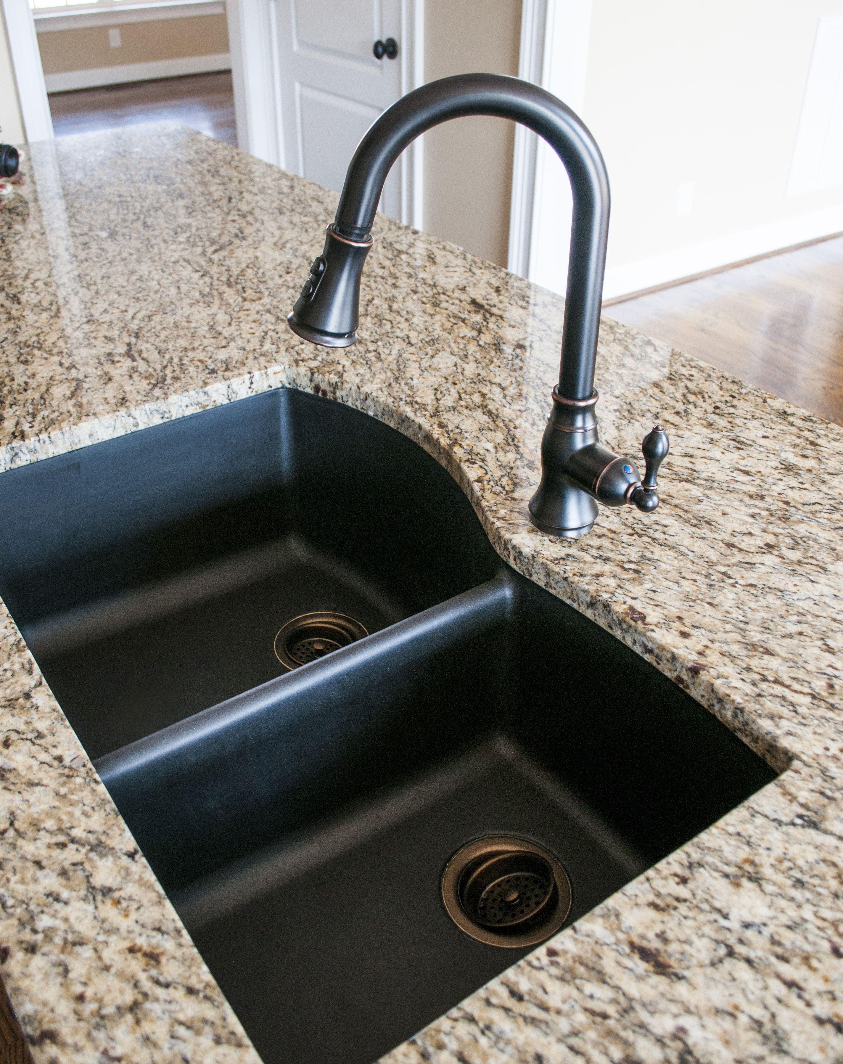 black granite sink and faucet photo - 2