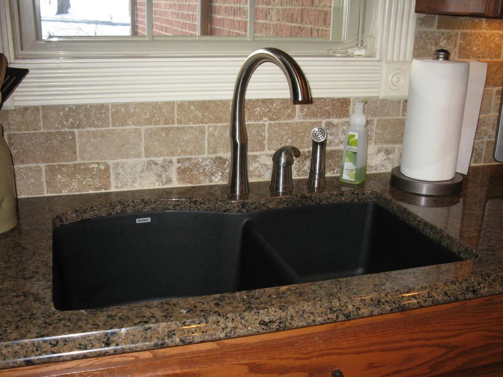 black granite sink and faucet photo - 6