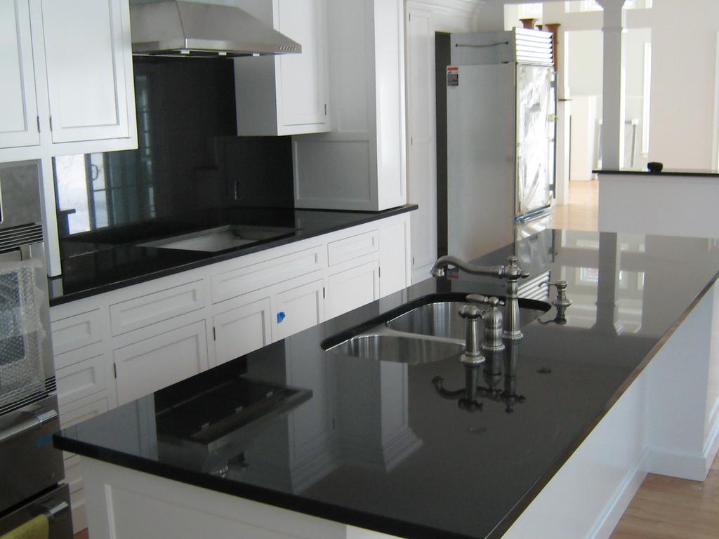 black kitchen cabinets and granite countertops photo - 9