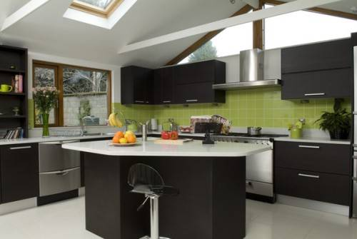 black kitchen cabinets and green walls photo - 1