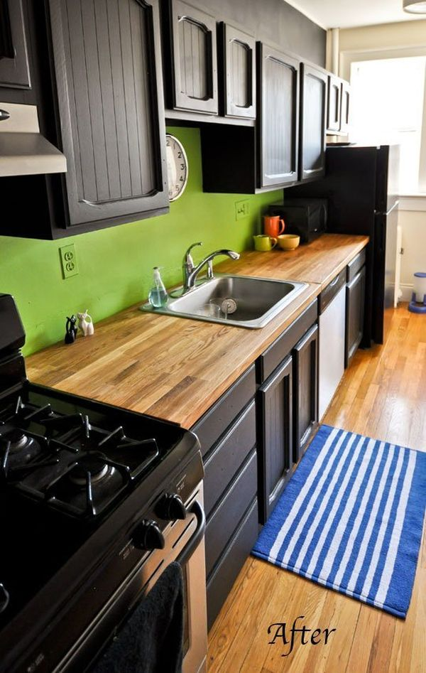 black kitchen cabinets and green walls photo - 8