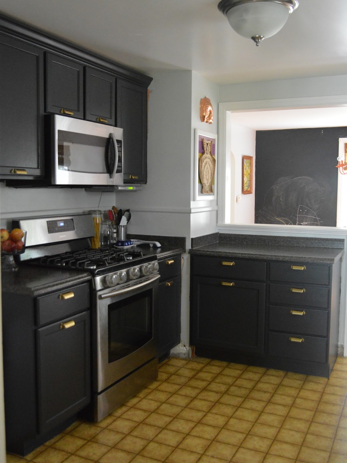 black kitchen cabinets and wall color photo - 3