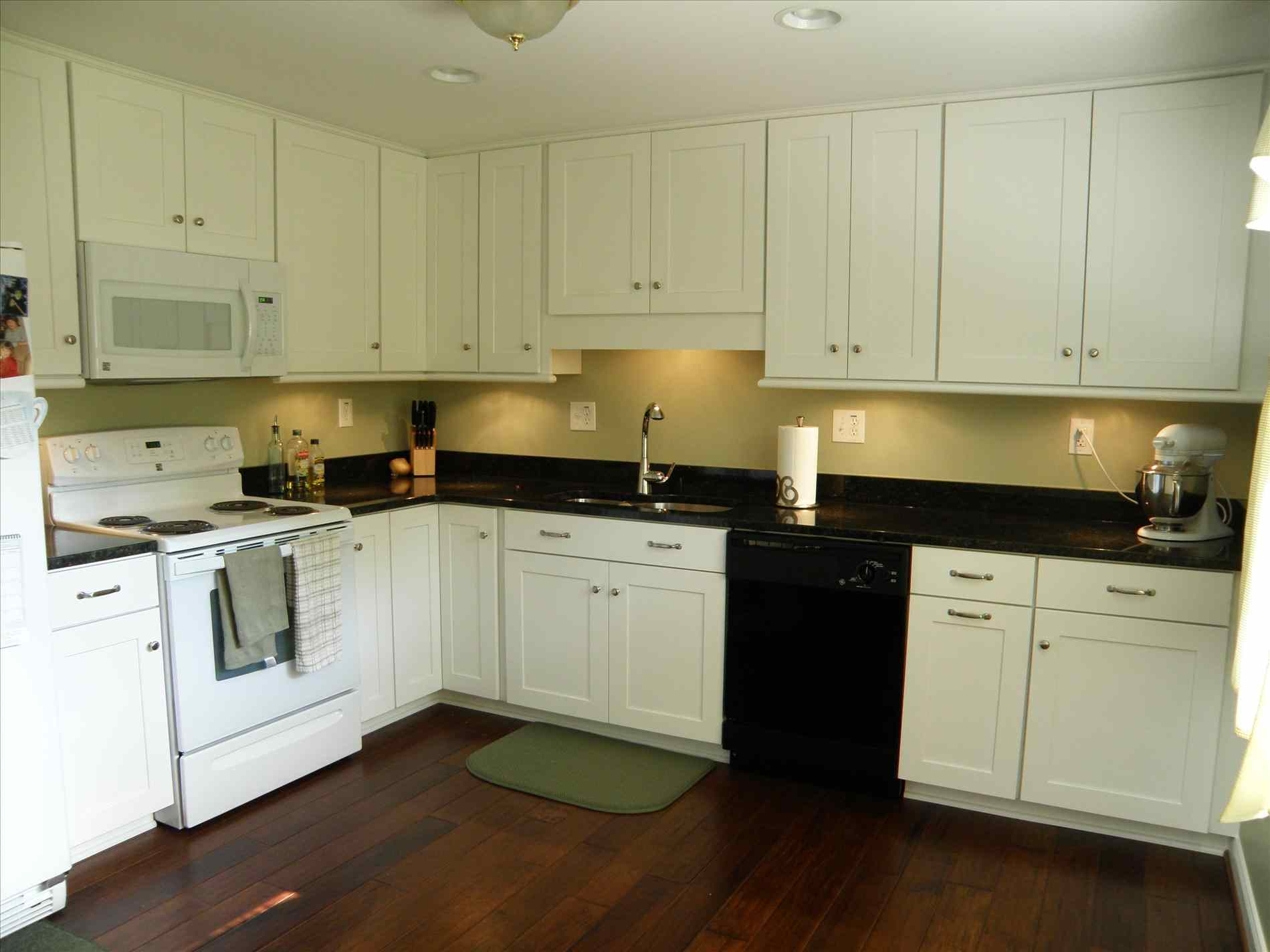 black kitchen cabinets and wall color photo - 8
