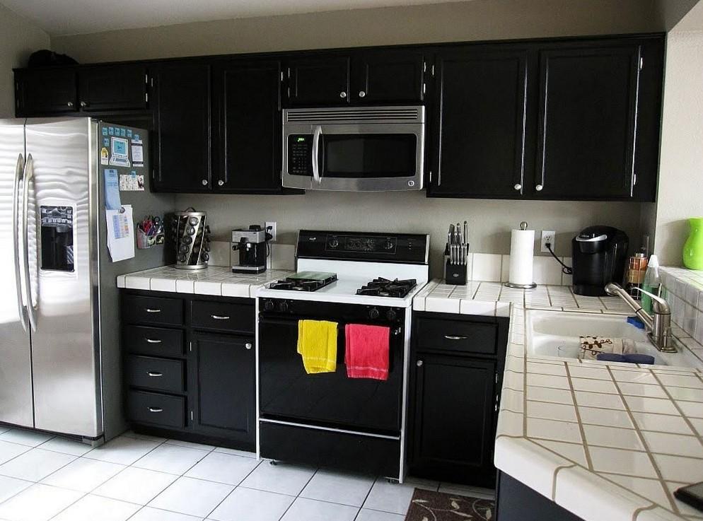 black kitchen cabinets in small kitchen photo - 1