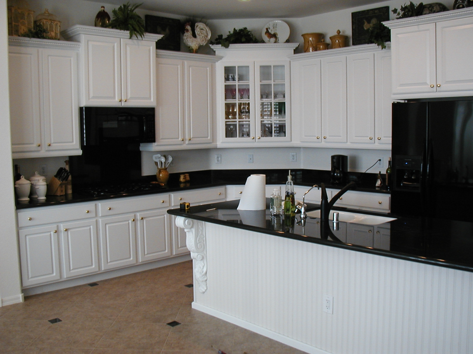 black kitchen cabinets with black appliances photo - 10