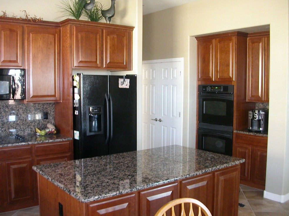black kitchen cabinets with black appliances photo - 3