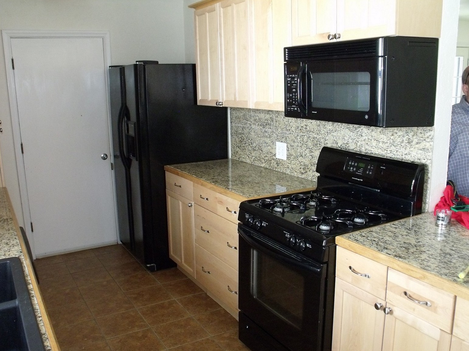 black kitchen cabinets with black appliances photo - 7