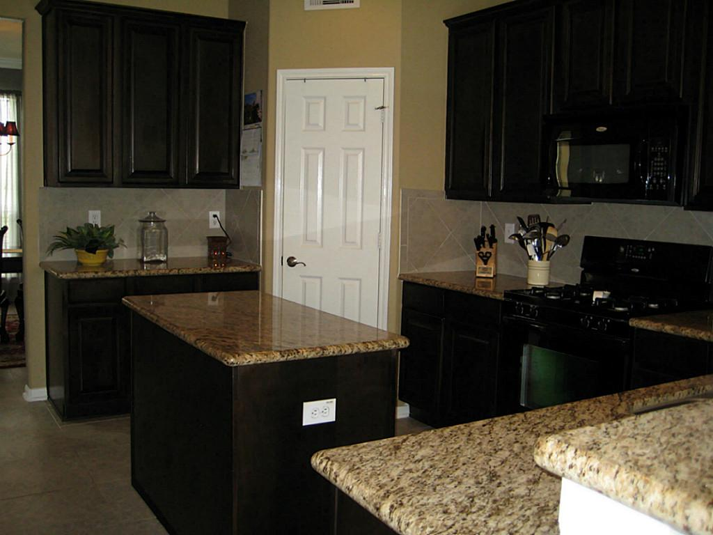 black kitchen cabinets with black appliances photo - 8