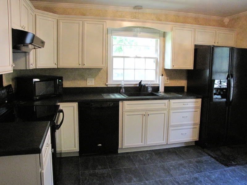 black kitchen cabinets with black appliances photo - 9
