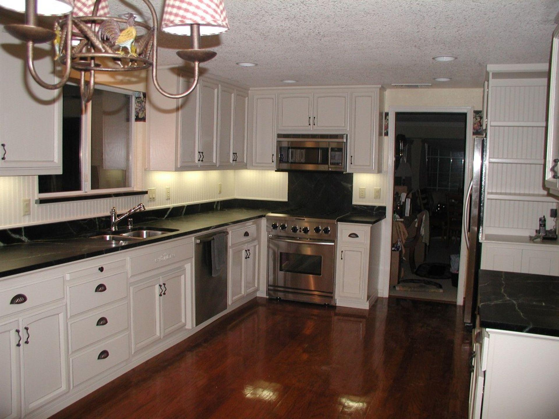 black kitchen cabinets with dark floors photo - 2