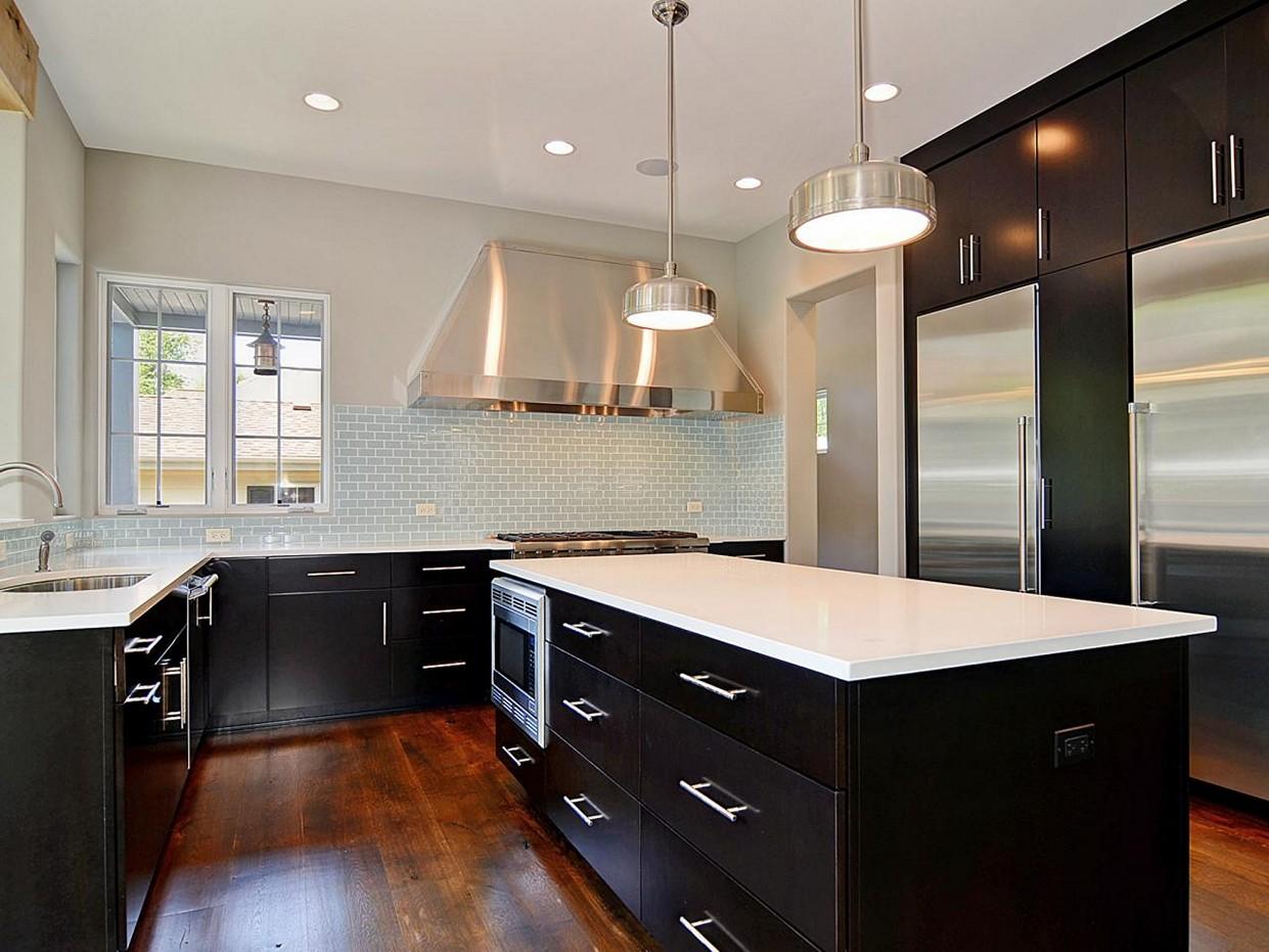 black kitchen cabinets with dark floors photo - 7