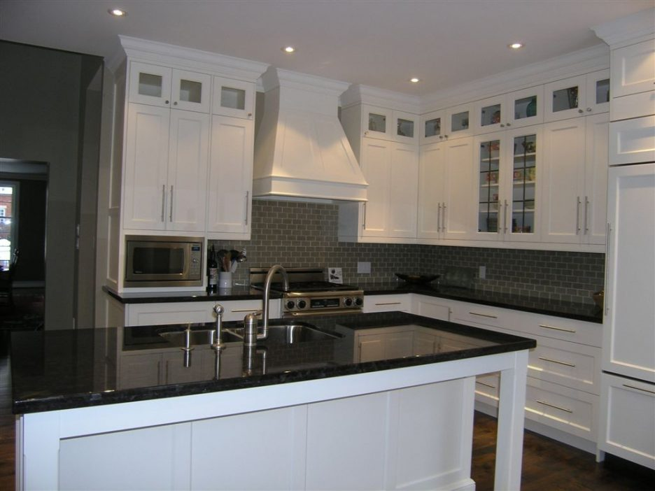 black kitchen cabinets with glass inserts photo - 9