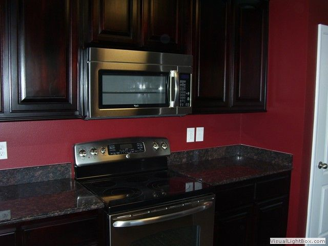 Black kitchen cabinets with red walls | Hawk Haven