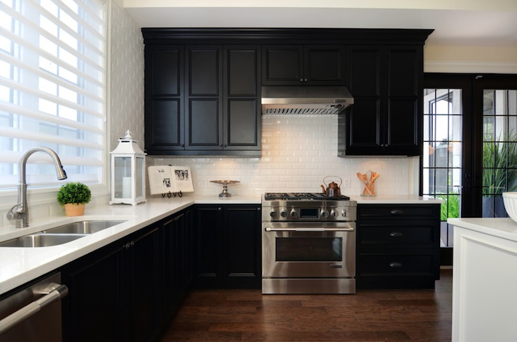black kitchen cabinets with white counters photo - 1
