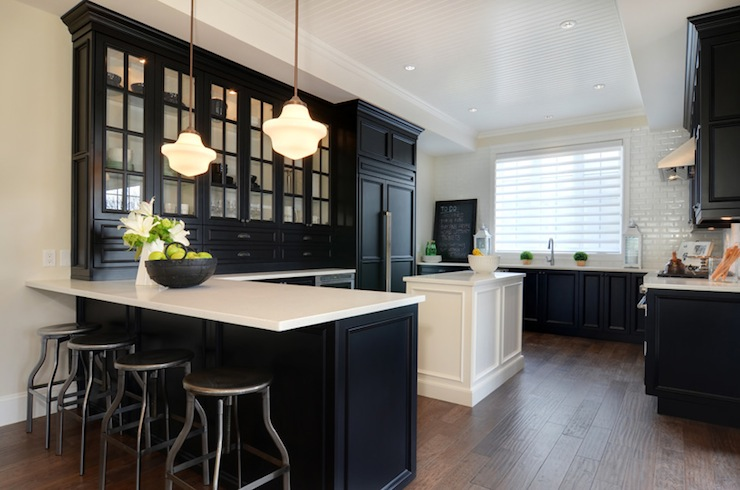 black kitchen cabinets with white counters photo - 10