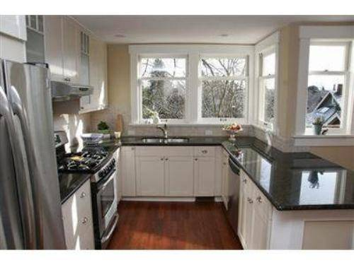 black kitchen cabinets with white counters photo - 2