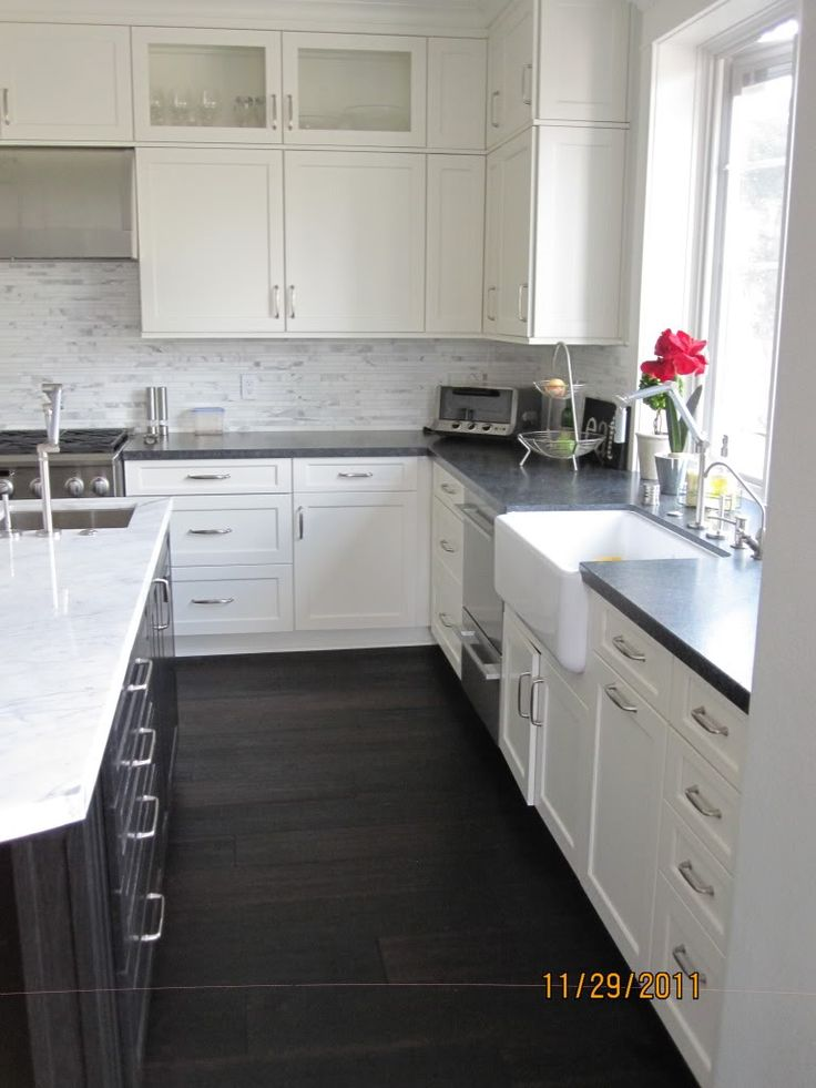 black kitchen cabinets with white counters photo - 4