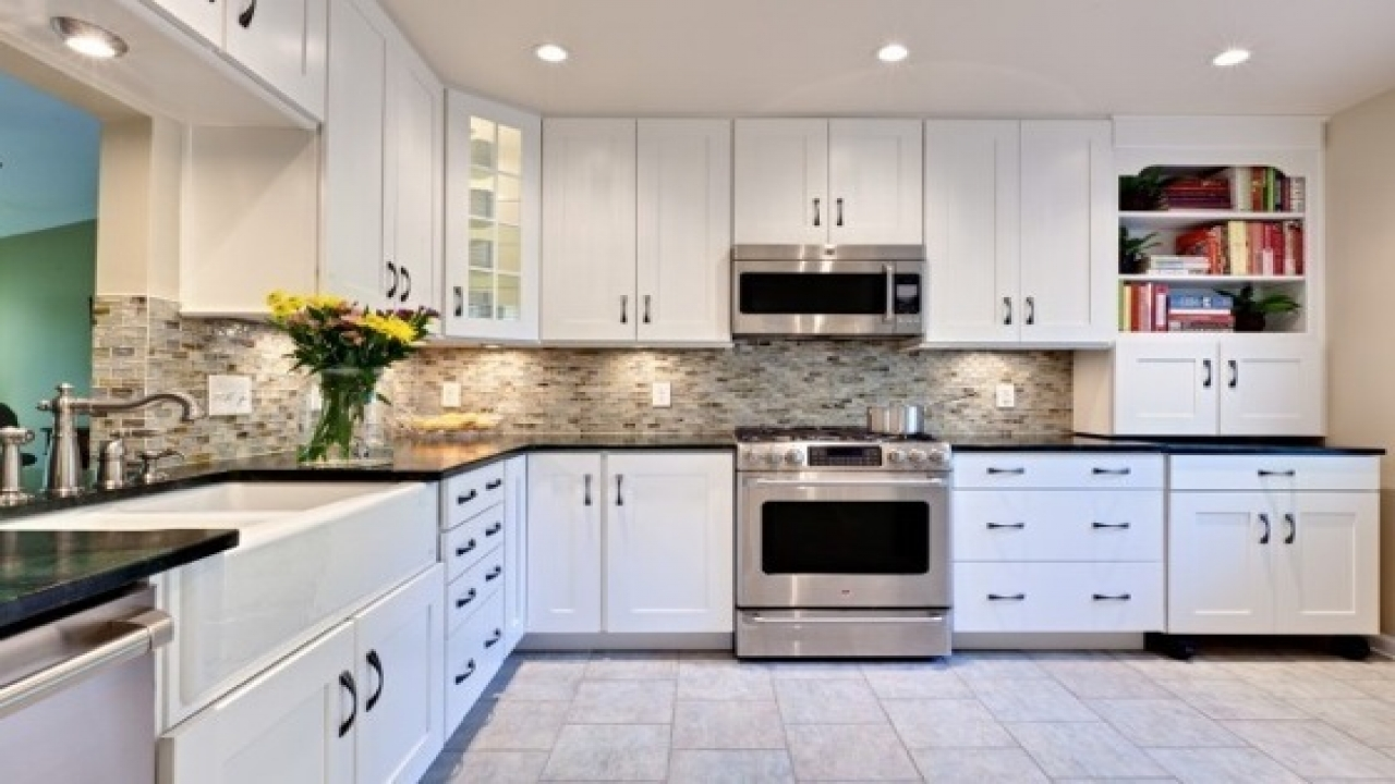 black kitchen cabinets with white counters photo - 7
