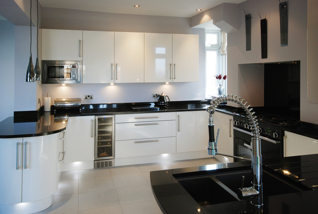 black kitchen cabinets with white counters photo - 9