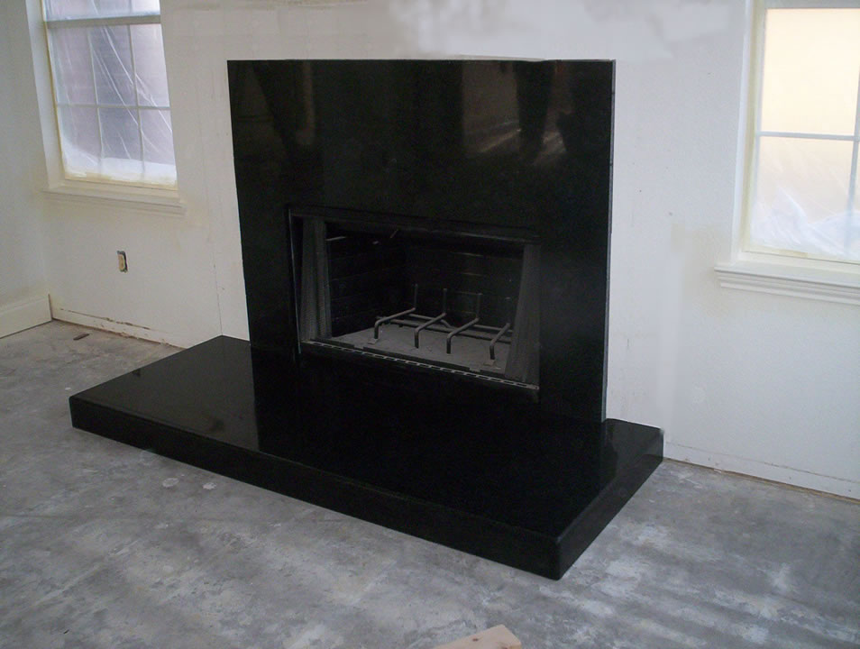 black marble fireplace surround photo - 3