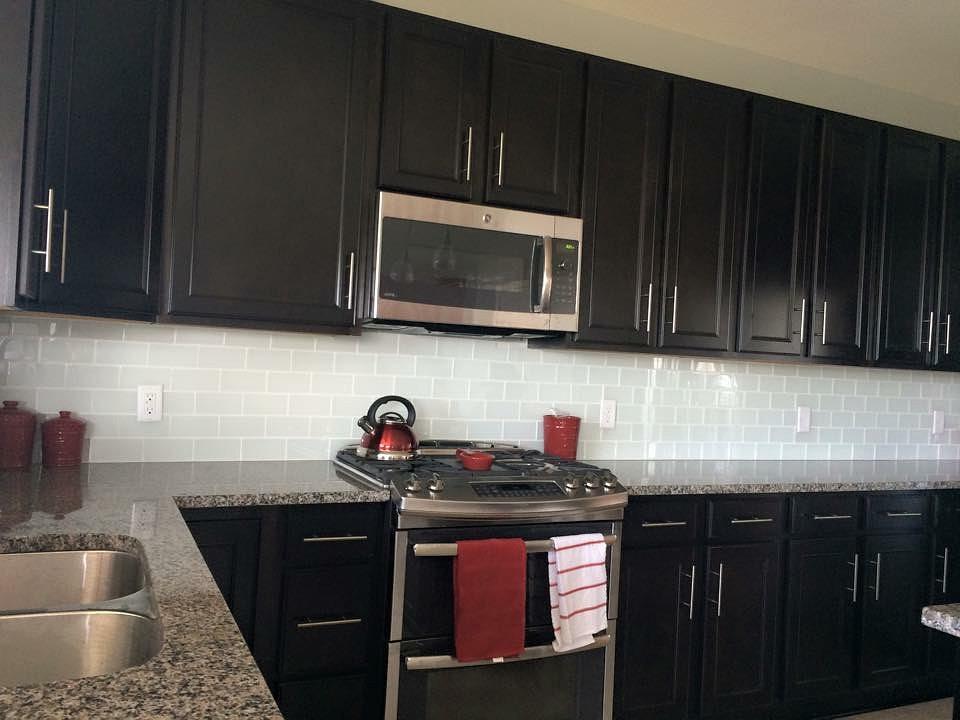 dark cabinets tile backsplash photo - 2