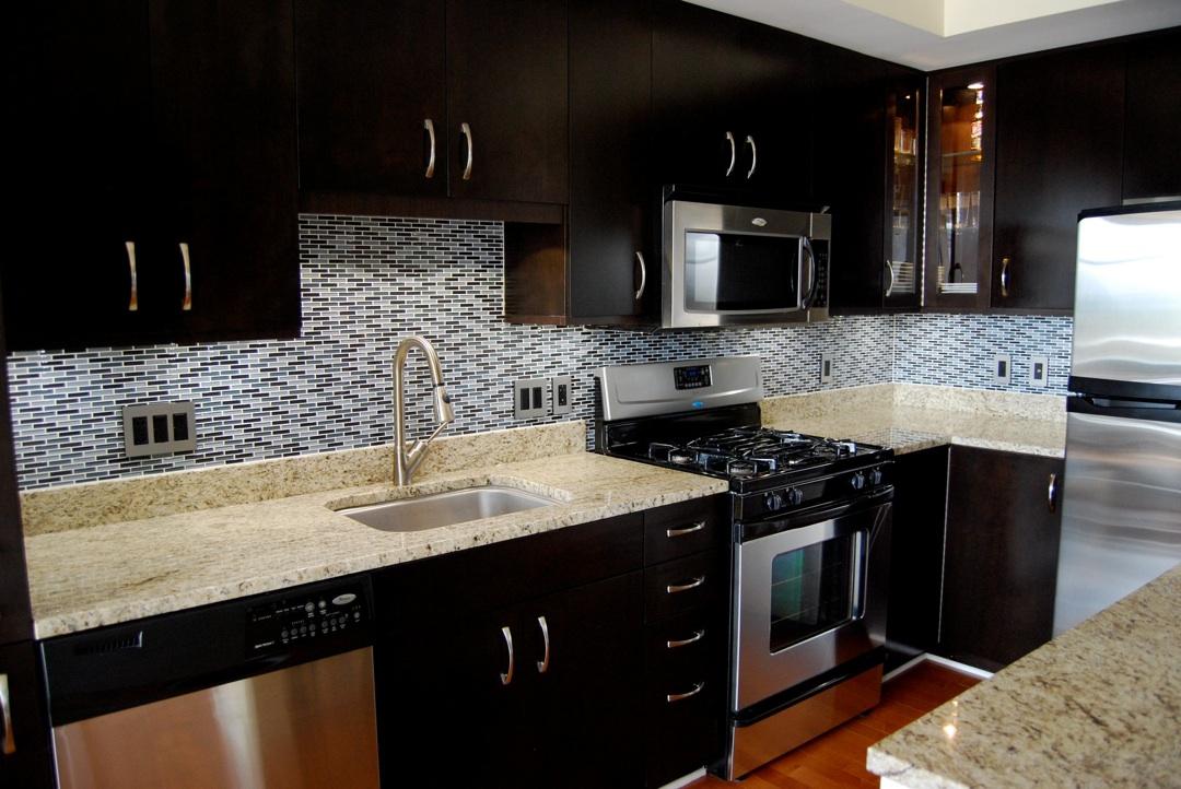 dark cabinets tile backsplash photo - 3