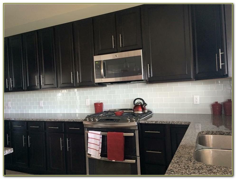 dark cabinets tile backsplash photo - 8
