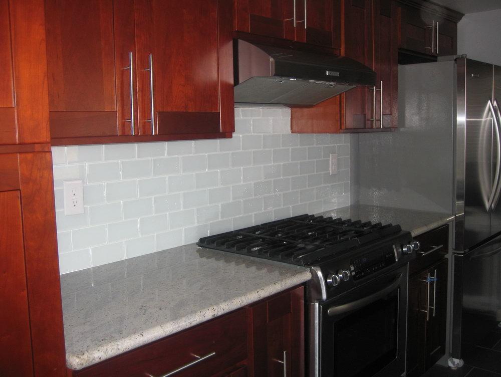 dark cabinets tile backsplash photo - 9