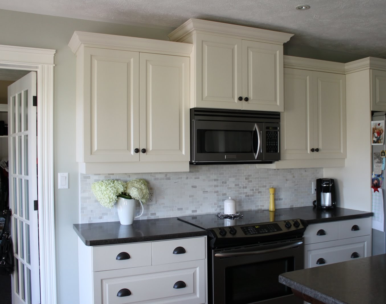 Dark cabinets white backsplash | Hawk Haven on Black Countertop Backsplash  id=13751