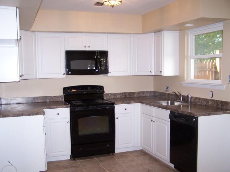kitchen white cabinets black appliances photo 10 - Black And White Kitchen Cabinets