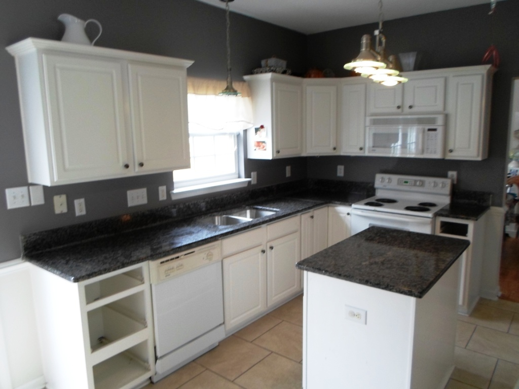kitchen white cabinets black countertops photo - 4