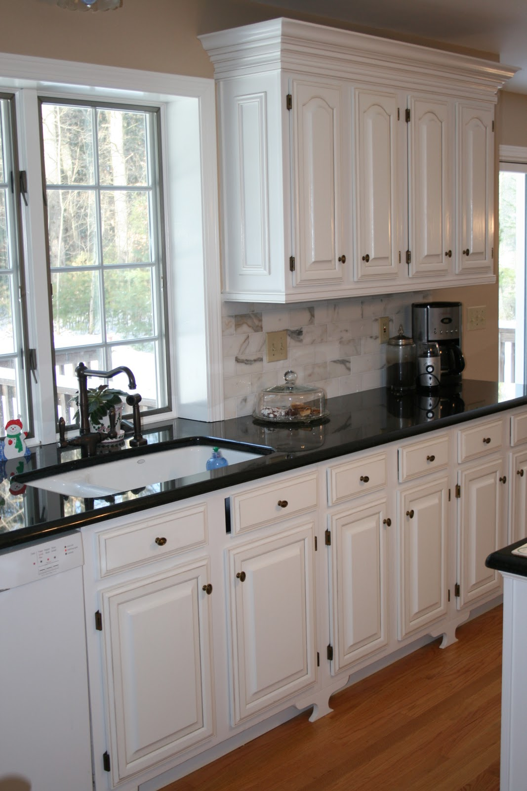 kitchen white cabinets black countertops photo - 6