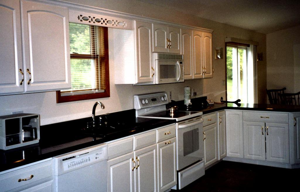 kitchen white cabinets black granite hawk haven