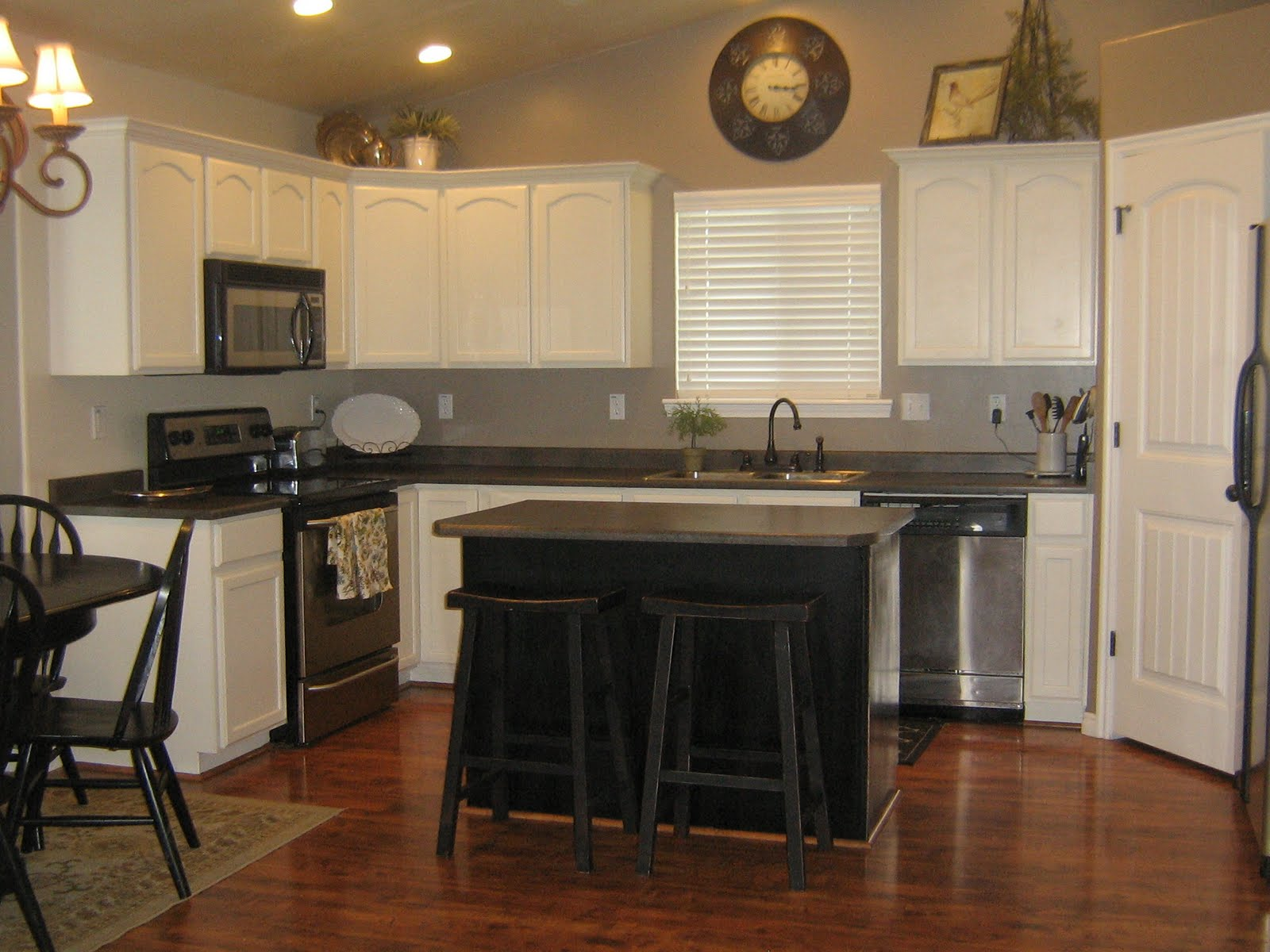 kitchen white cabinets black island photo - 7