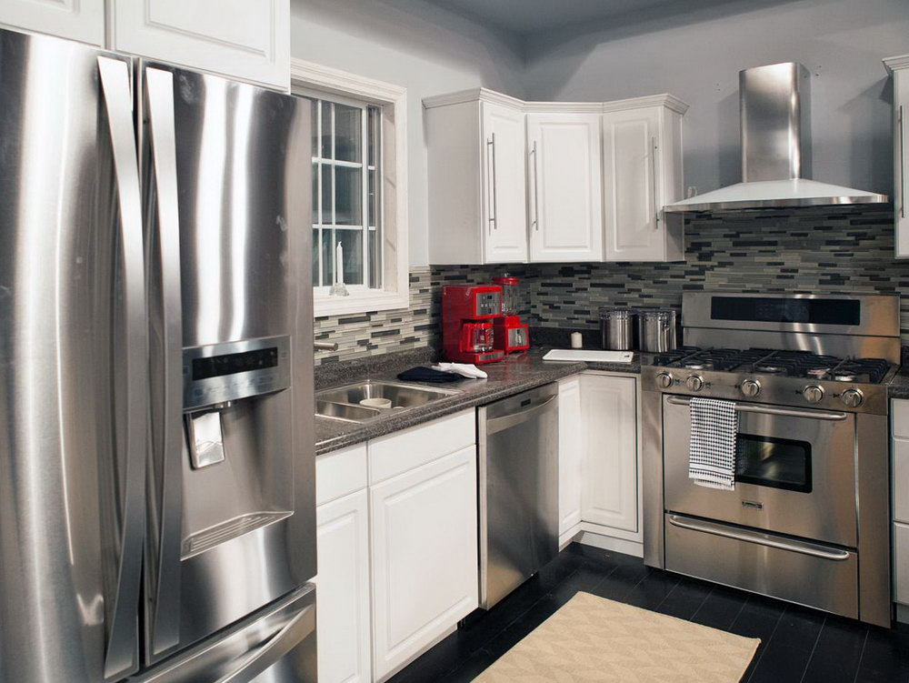 kitchen white cabinets stainless appliances photo - 10