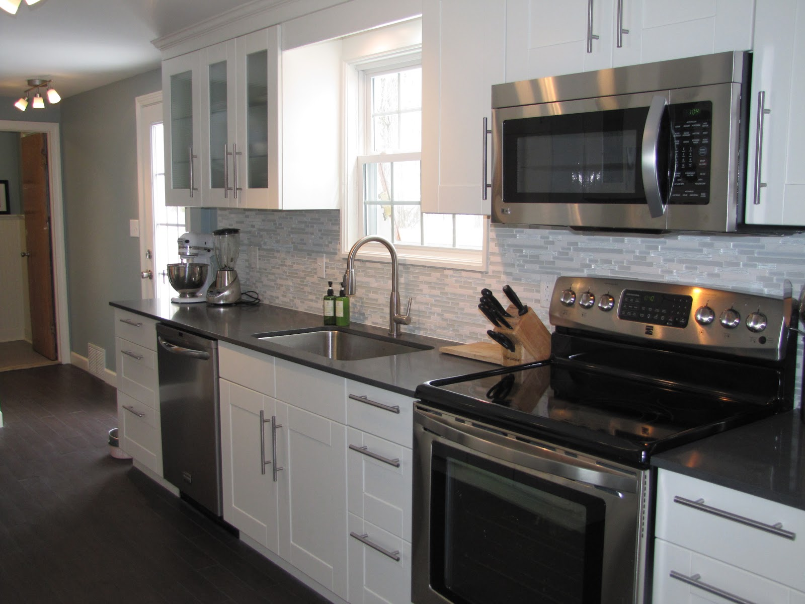 kitchen white cabinets stainless appliances photo - 8