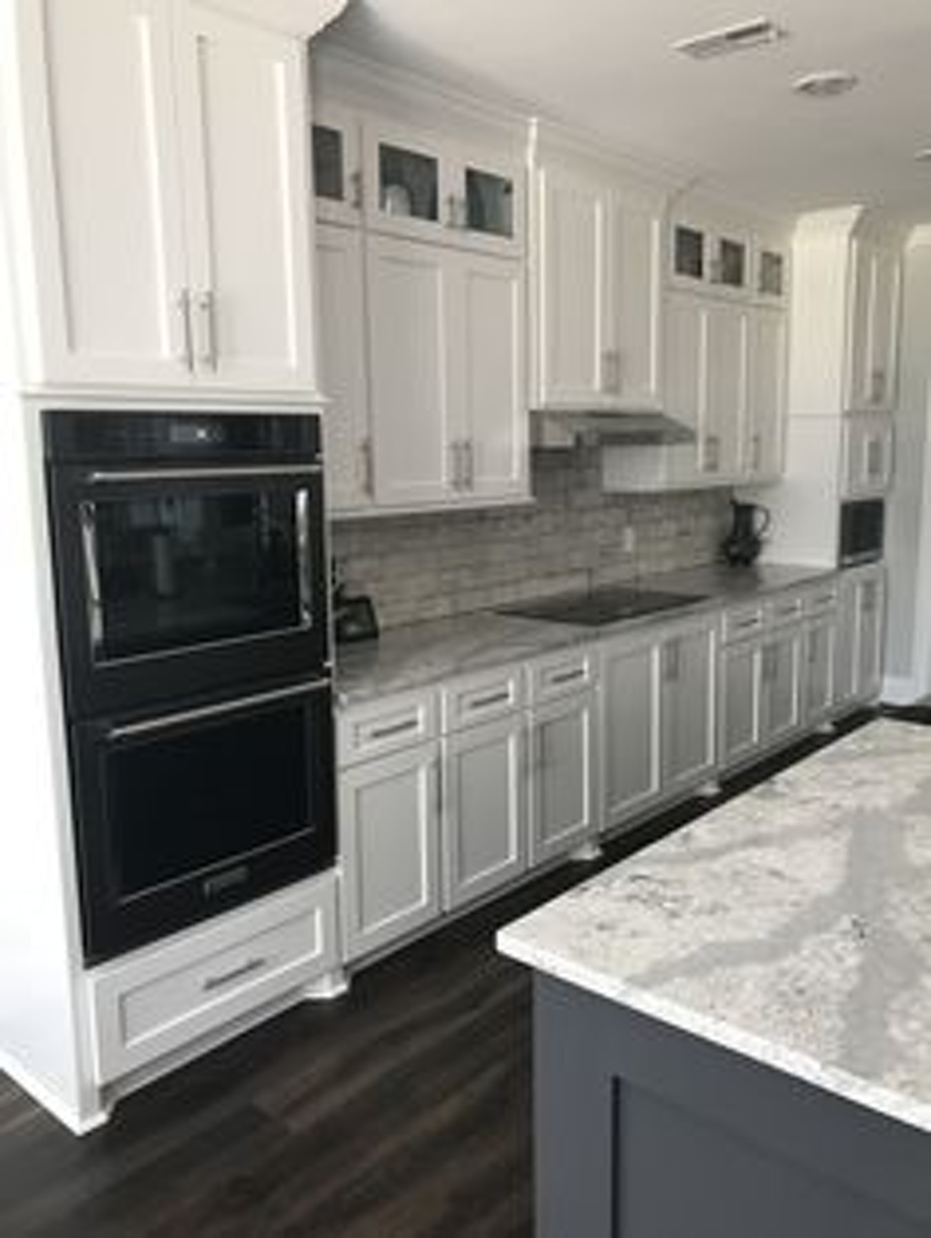 kitchen white cabinets stainless appliances photo - 9