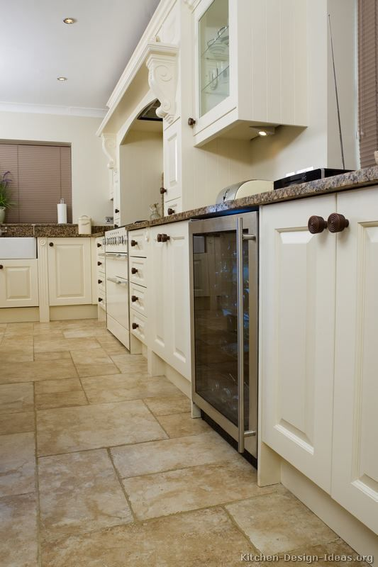 Kitchen white cabinets tile floor | Hawk Haven