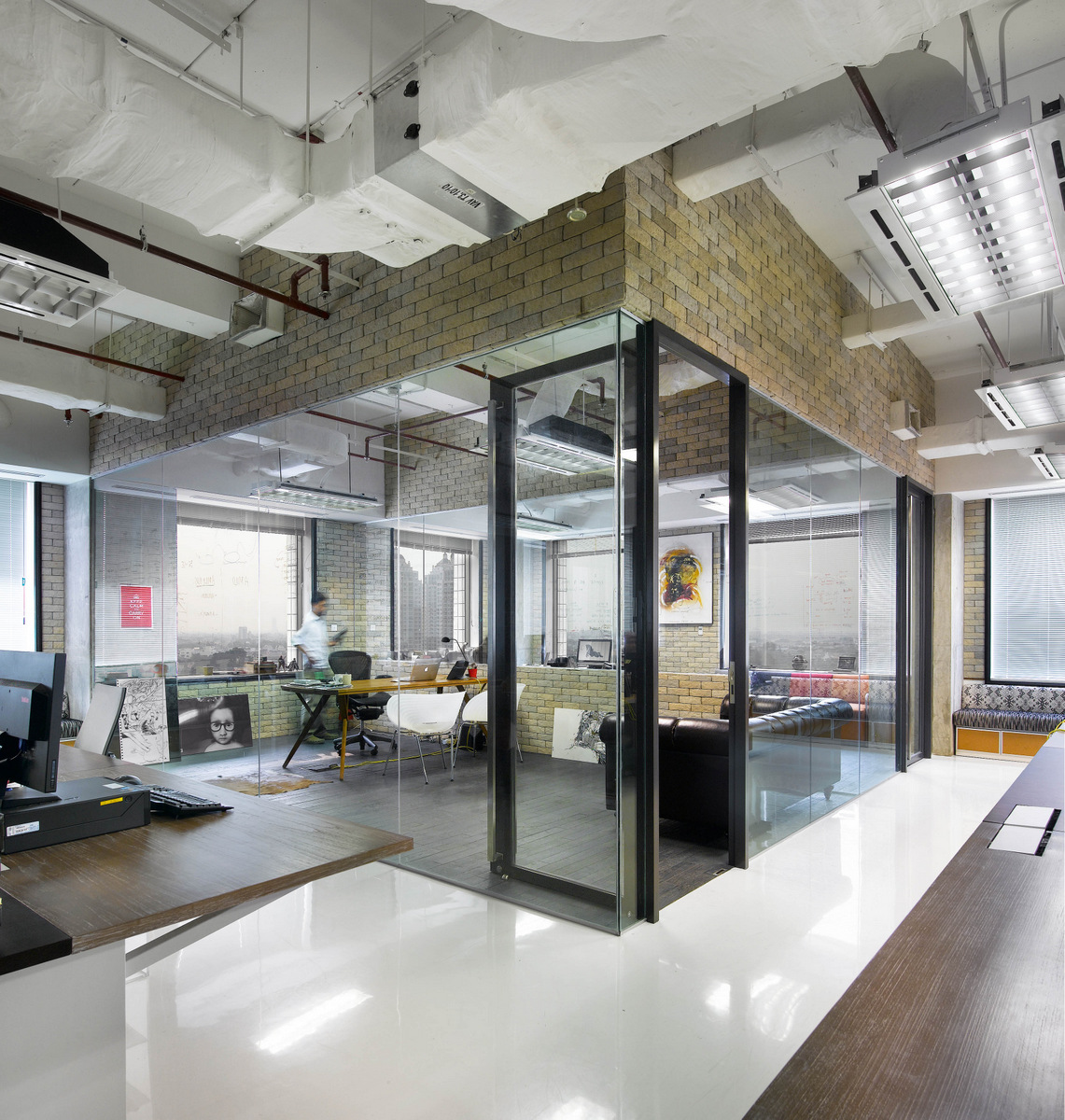 office space with glass walls photo - 3