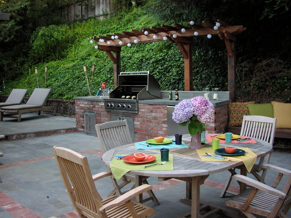 outdoor dining table with grill photo - 2
