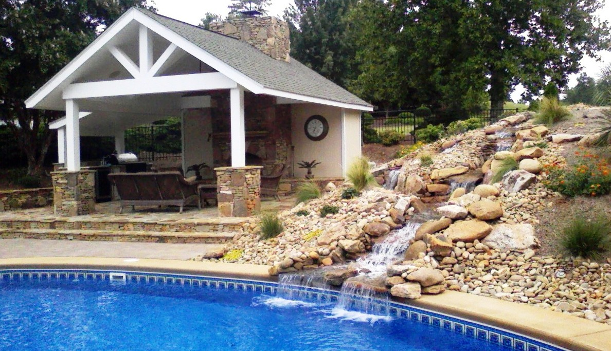 outdoor kitchen and pool photo - 10